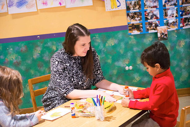 Teacher working with a PreK student one-on-one.